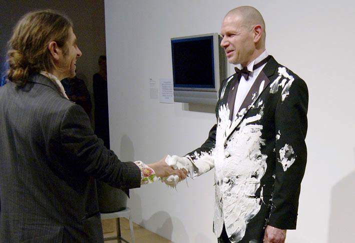 Roi Vaara (right), Wet Paint Handshakes (2008, performance in Hayward Gallery, London, black tuxedo, white paint). Photo: © Naranja. Image obtained from Roi Vaara. Use of image obtained from Roi Vaara